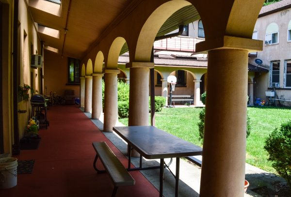 The courtyard is lined by a long porch.