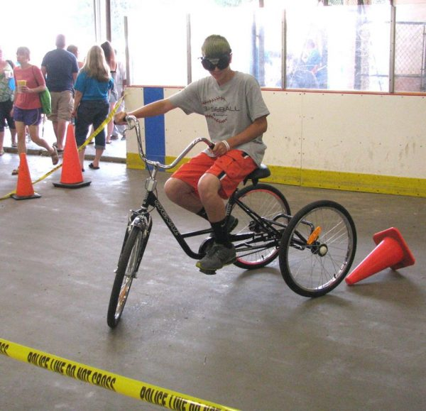 "Even operating a three-wheeler is difficult when wearing the ""drunk goggles"" made available by local law enforcement."
