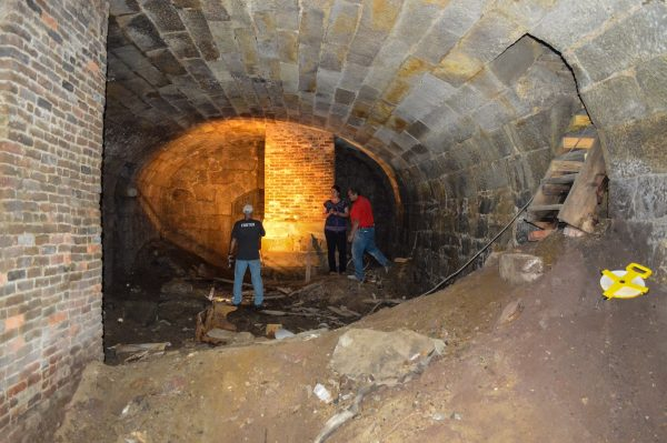 Wheeling Heritage historian Rebekah Karelis examines the cellar that's located beneath an apartment complex on the north end of Wheeling Island.