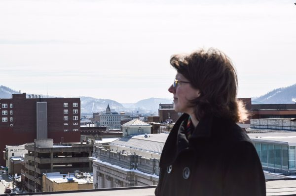 Ward 4 Councilwoman Wendy Scatterday looks over the Friendly City's downtown district from atop the Wheeling YWCA building on Chapline Street.