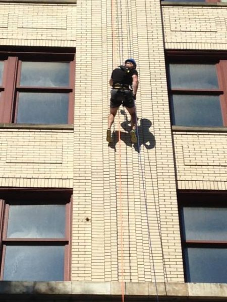 "Fluharty participated in the YWCA's ""Over the Edge"" fundraiser this past August."
