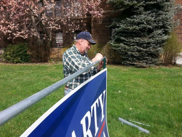 Fluharty's father assists the lawmaker's campaign with the campaign signs located throughout the Third House District.