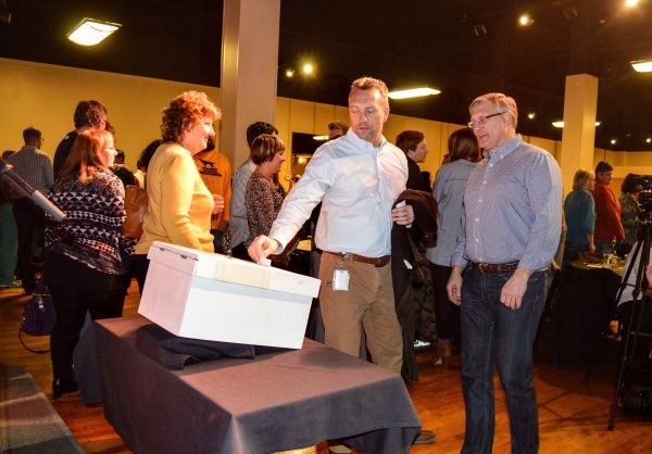 "Wil Turani, the director of operations and sustainability for Orrick in Wheeling, casts his vote during the ""Show of Hands"" event in February."