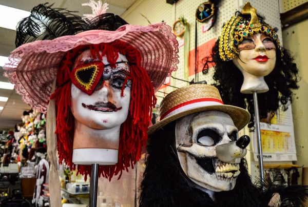 The costume shop shop offers masks and makeup to fit a customer's wish.