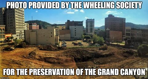 Preservation is playing a big role in the revitalization of downtown Wheeling but the eartwork on the Health Plan's construction site lent itself to this image and coinciding satirical story.