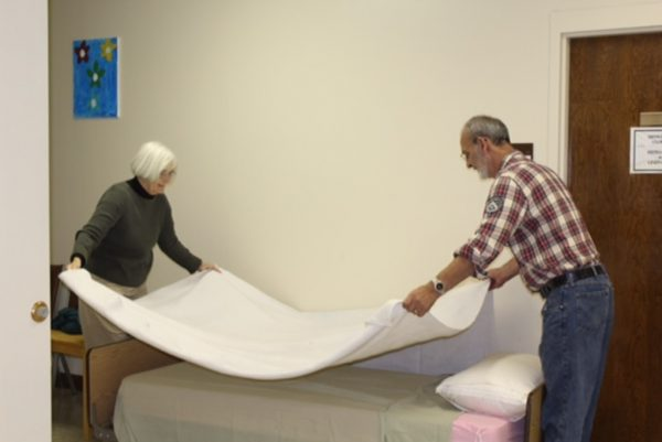 Working together, Lynda Bryant and John Moses( YSS CEO) made quick work of making beds.