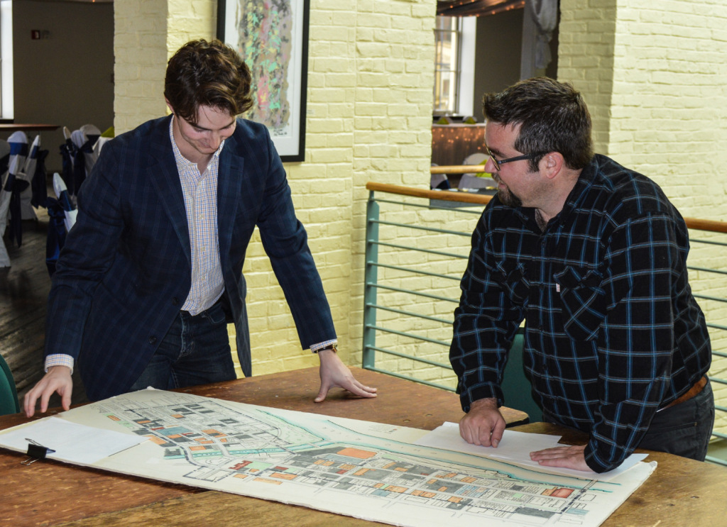 ReInvent Wheeling's Jake Dougherty reviews one of many maps of downtown Wheeling with Jeremy Morris, the executive director of the Wheeling National Heritage Area Corp.