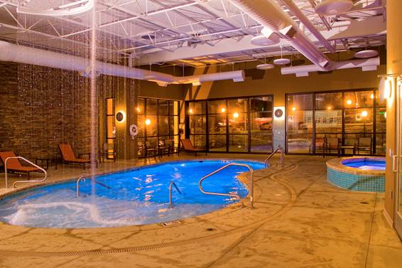 The Aquatic Center offers an indoor pool, indoor and outdoor hot tuns, a splash deck, a pair of steam rooms and a rain forest shower.