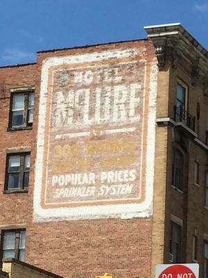 """The Hotel McClure ghost sign downtown proudly boasts """"300 rooms, popular prices [and a] sprinkler system."""""""