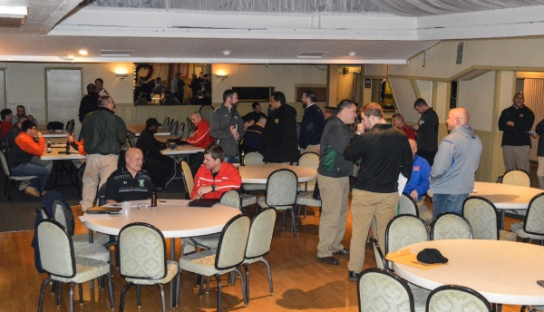 The banquet room at Generations Restaurant and Pub in Wheeling was crowded with football coaches Wednesday evening. More than 30 coaches from the Ohio Valley Athletic Association met with two dozen NCAA Division I and II coaches in an effort to acquire opportunities for scholastic student/athletes.
