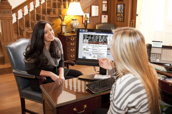 Olivia Morgan discusses social media strategy with potential client Jenna Heaston.