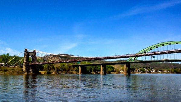 Today, the Suspension Bridge - the first structure to span the Ohio River - rests adjacent to the Fort Henry Bridge.