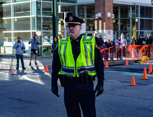 Wheeling Police Chief Shawn Schwertfeger is as hands-on as he can be, including taking his turn on traffic duty during the annual Veterans Day Race in downtown Wheeling.