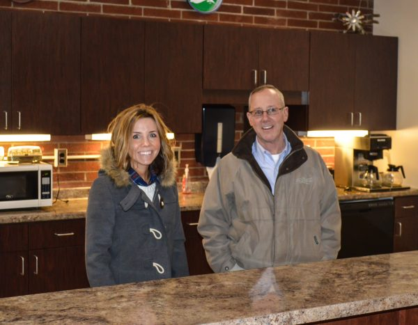Carl and Erin visit the new lunch room that was constructed when the Carenbauers decided to expand the warehouse by 8,000 square feet.
