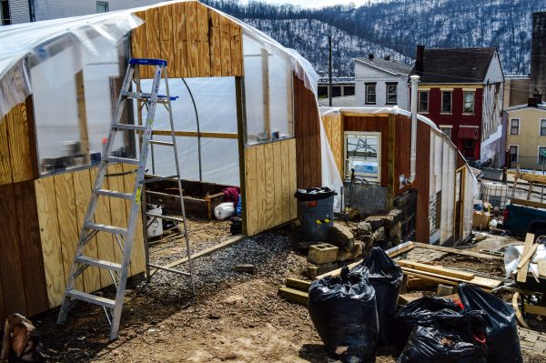 Swan's dream began with one greenhouse, but the project expanded to include two grow houses.