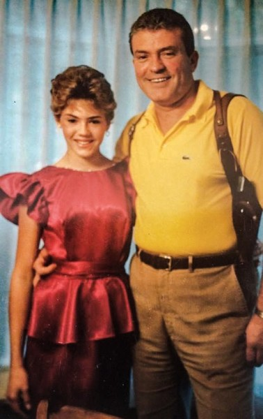 Former FBI agent Tom Burgoyne poses with his daughter Erin before she attended a formal dance in the late-1980s. Erin did report that Tom removed his firearm before answering the door when her date arrived.