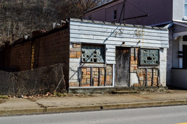 """This old bar in South Wheeling - """"Wally's"""" - has been closed for more than two decades after a fire. Current residents still wonder why the structure remains standing today."""