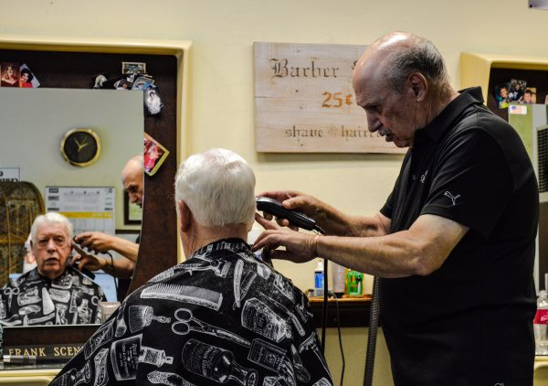 Frank Scenna has been cutting hair on Edgington Lane since March 1960, and customers like Lou Pastoria continue to make monthly visits a part of their routine.