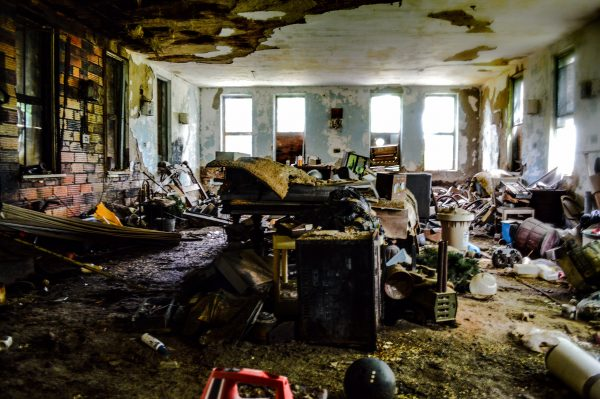 There are few large patient rooms in the facility, but each have become clutter with junk since the hospital closed in 1972.