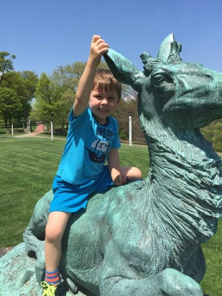 "A member of Wheeling's next generation sits astride ""The Stag"" on late spring afternoon."