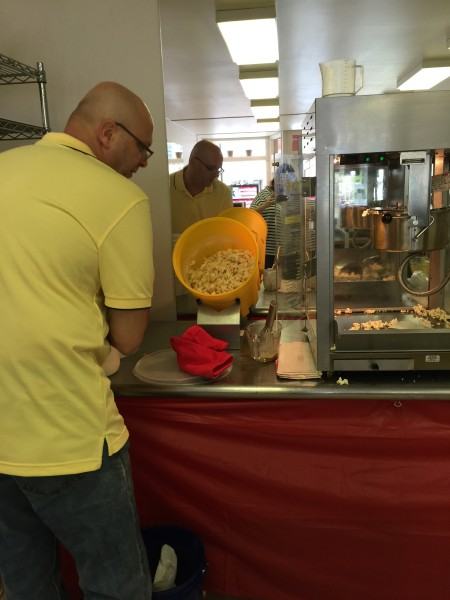 Dave McFarland mixes a new batch of popcorn at the new shop at Market Plaza.