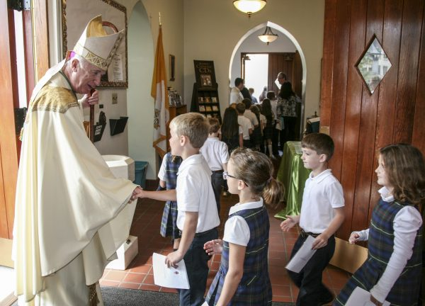 Bishop Bransfield meets with St. Michael's student.