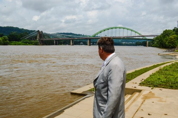 Glenn keeps an eye on the Ohio River because he is a resident of Wheeling Island.