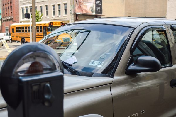 The city's two meter maids issue more than 100 parking tickets each week in downtown Wheeling.