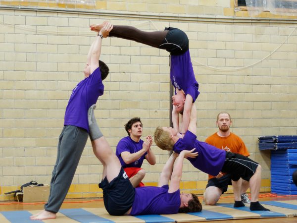Olney Friends School students demonstrate their strength and athletic skills during the annual Gymnastics Exhibition.