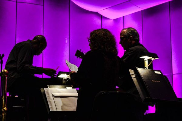 Maestro Andre Raphel works rehearses with Tim and Molly O'Brien earlier this year at the Capitol Theatre.