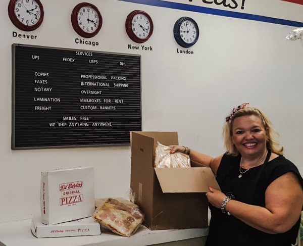 Staci Spry's Mail Center Plus often ships DiCarlo's Pizza to destinations across the country.