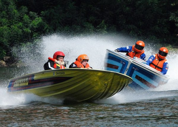 The vintage raceboats travel at high speeds as long as the river if fairly free of debris.