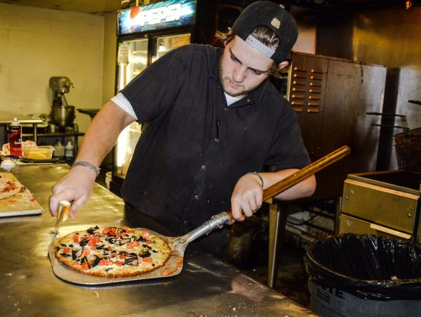 Joey Yoho serves up one of many pizzas that are enjoyed each Tuesday evening.