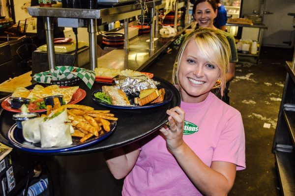 Server Dawn Pagels is ready to deliver dinner to one of the many tables filled with Team Trivia participants.