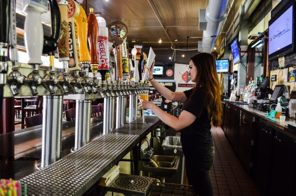 Alisha Scott serves up on of 24 drafts available at River City.