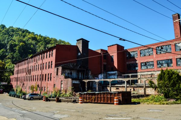 The enormous building rests along Big Wheeling Creek near Carenbauer Distributing.