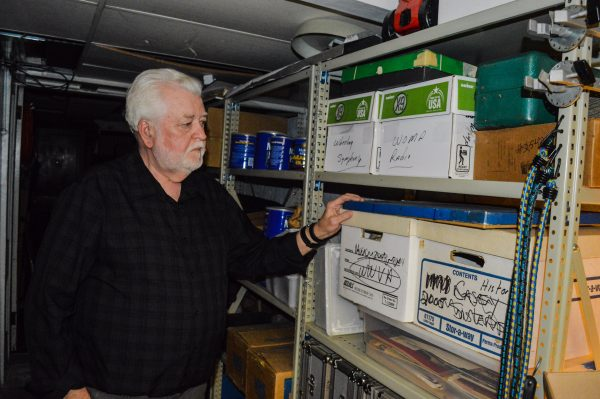 Thorton shows where he keeps hundreds of images connected to Wheeling radio history.