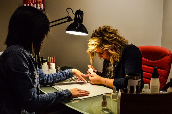 Sarah Smith works on a client's nails.