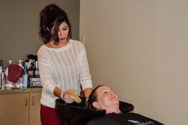 Melonie Merigo shampoos a client at the Woodsdale area spa.