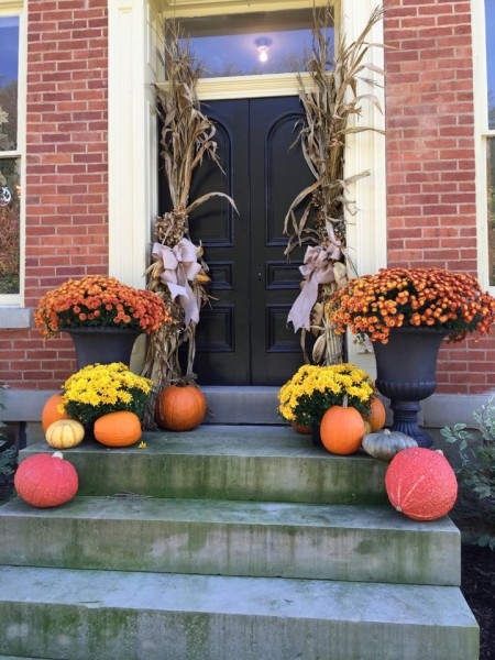The front of the historic home, now coffee and gift shop, decked out for fall.