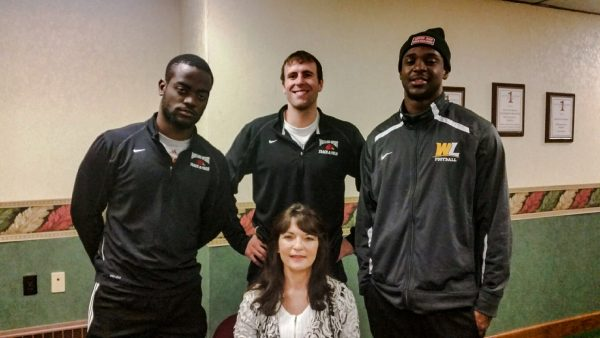 """Sharon Travis, seated in front, founded the """"Living Free"""" program this year. Standing with Travis are, from left to right, are Kenny Assasse (Young Life leader), Travis McKinley (Young Life leader), and Jerimy Mask (Young Life leader)."""