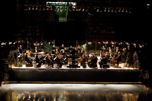 The venue will much different from the members of the Wheeling Symphony Orchestra but maestro Andre Raphel will be on stage to conduct.