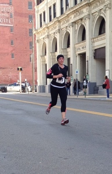 Wheeling resident Brittany Gaus makes her way to the finish line along 14th Street.