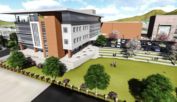 A four-story building and a courtyard area are included in the design of the new building.