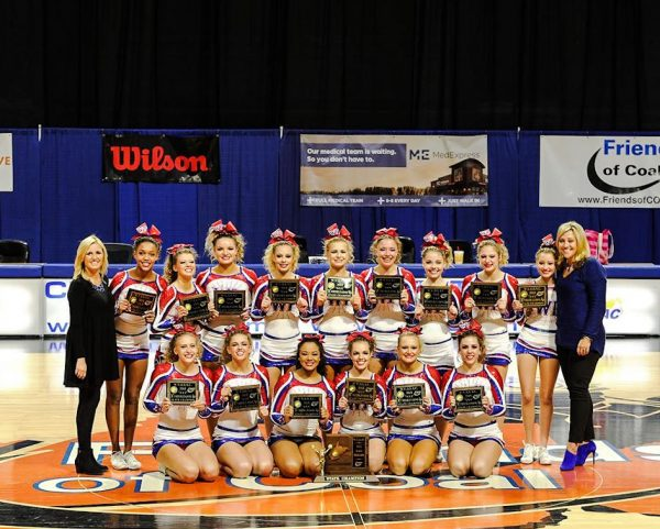 Assistant coach Kristi Taylor joins head coach Shawna Shperd and the Wheeling Park champions.