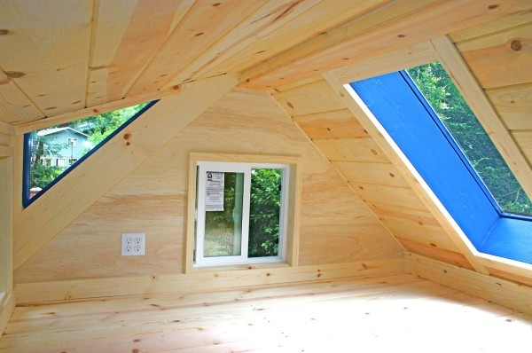 Each tiny home would feature a small bedroom loft.