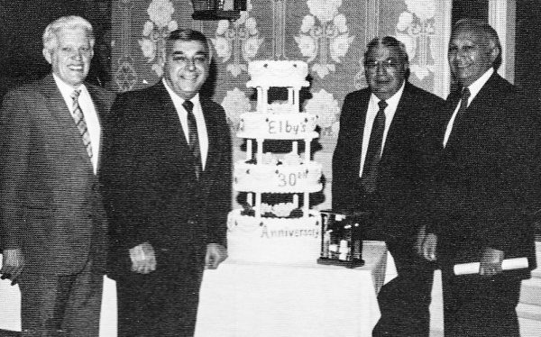 The Boury brother celebrated Elby's 30th anniversary in 1986. From left are Vice President Tom Johnson, and Mike, George, and Ellis Boury.