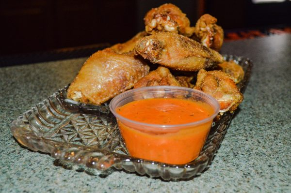 """Ozzie's five-spice wings with a side of """"Ozzied Sauce."""""""