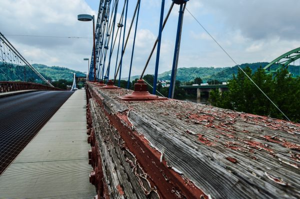 The $8 million renovation and beautification project for the historic Wheeling Suspension Bridge has been delayed for four years despite the efforts of Mayor McKenzie and city officials.