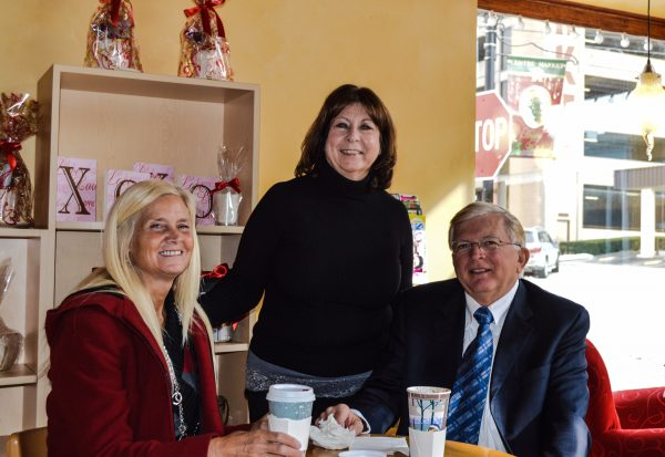 Theresa Childers visits with two loyal Centre Cup customers, Dr. Howard and Joyce Shackelford of Wheeling.